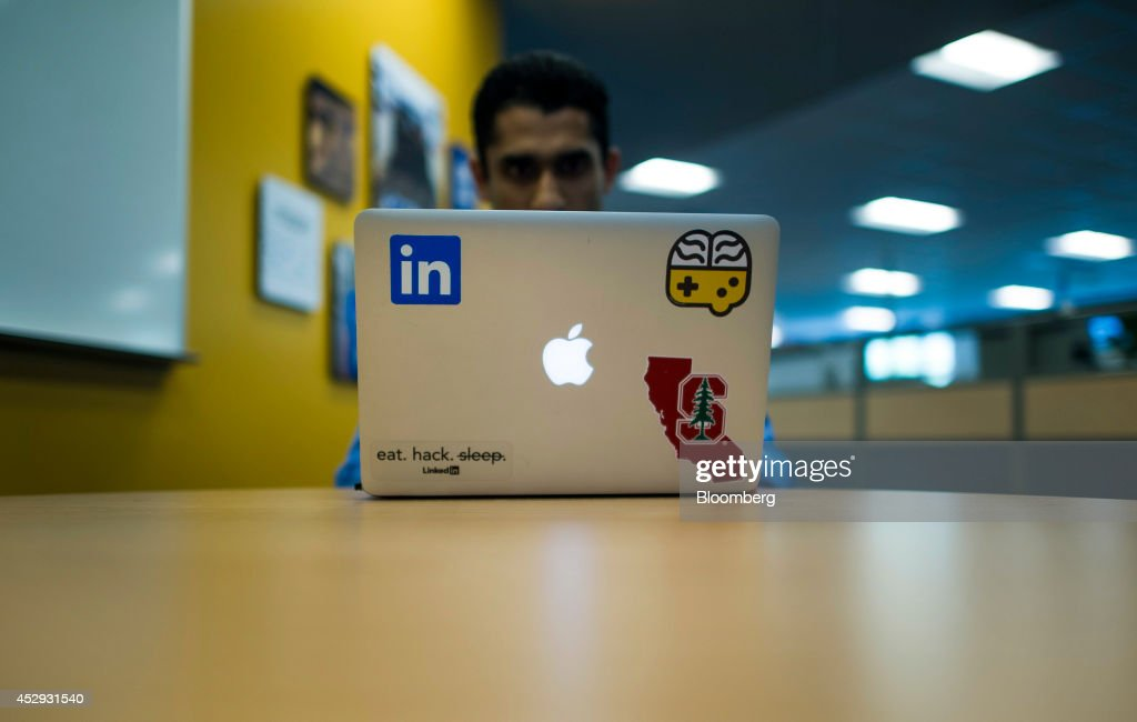 An employee works on an Apple Inc. laptop computer at LinkedIn Corp. headquarters in Mountain View, California, U.S., on Monday, July 28, 2014. LinkedIn Corp. is scheduled to release earnings figures on July 31. Photographer: David Paul Morris/Bloomberg via Getty Images