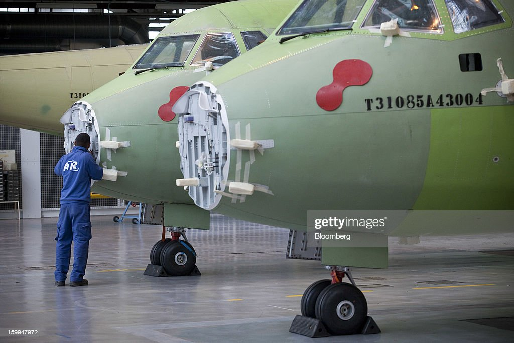 An employee works on an ATR 72 turboprop aircraft, manufactured by Avions de Transport Regional (ATR), at the company's production facility in Colomiers, France, on Wednesday, Jan. 23, 2013. ATR, the world's largest maker of turbo-propeller airliners, reported record profit for 2012, even as it fell short of its shipment target amid production delays. Photographer: Balint Porneczi/Bloomberg via Getty Images