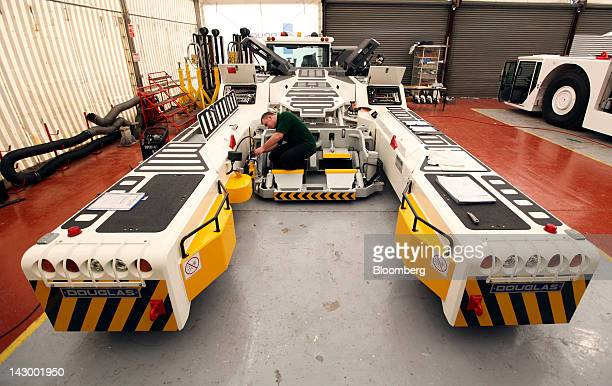 An employee works on an aviation towing tractor at the Douglas Equipment plant owned by CurtissWright Corp in Cheltenham UK on Tuesday April 17 2012...