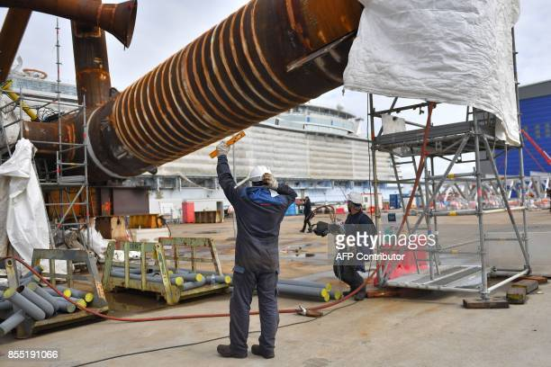 An employee works on an electric substation for an offshore windmill park at the site of French shipyard STX in SaintNazaire western France on...