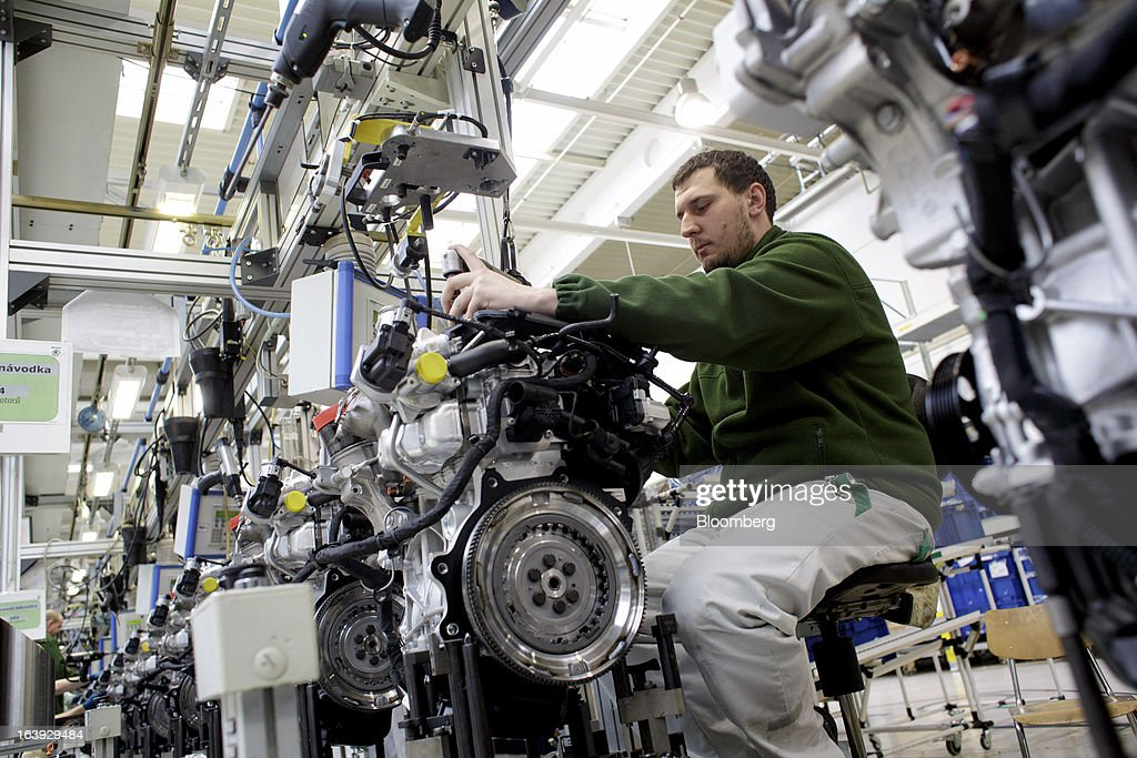 An employee works on an engine assembly at the Skoda Autos AS plant in Mlada Boleslav, Czech Republic, on Friday, March 15, 2013. VW, which also owns the Porsche luxury-auto brand as well as the Skoda and Seat volume marques, will build at least 10 plants globally, including seven in China, Martin Winterkornm chief executive officer of Volkswagen AG, said. Photographer: Martin Divisek/Bloomberg via Getty Images