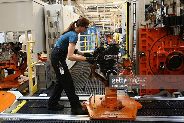 An employee works on an engine production line at a Ford factory on January 13 2015 in Dagenham England Originally opened in 1931 the Ford factory...
