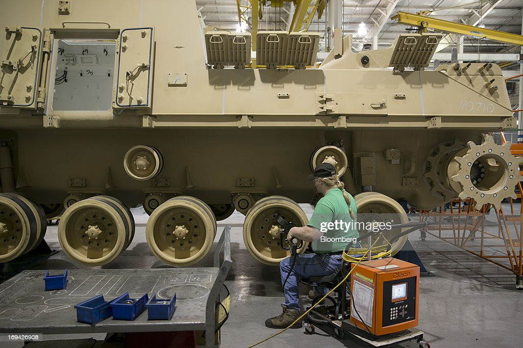 An employee works on assembly of the M88 Hercules heavy recovery vehicle on the production line at the BAE Systems Plc Land & Armaments facility in York, Pennsylvania, U.S., on Thursday, May 23, 2013. BAE Systems Plc is deploying smaller suppliers to pressure U.S. lawmakers to speed up orders to modernize Bradley fighting vehicles, a move the company said may protect thousands of subcontractor jobs and keep a Pennsylvania assembly line open. Photographer: Andrew Harrer/Bloomberg via Getty Images