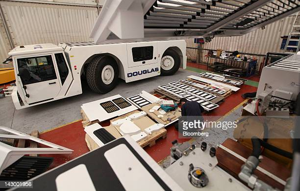 An employee works on bodywork panels for of an aviation towing tractor at the Douglas Equipment plant owned by CurtissWright Corp in Cheltenham UK on...