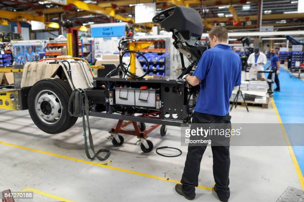 An employee works on electrical components of an Enviro 200 bus under construction at the Alexander Dennis Ltd factory in Guildford UK on Monday Sept...