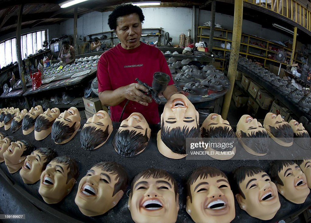 An employee works on masks of Brazilian football star Neymar, at the carnival masks factory Condal, in Sao Gonçalo, about 35 km from downtown Rio de Janeiro, on January 9, 2013. Rio's world famous carnival takes place February 9-12.