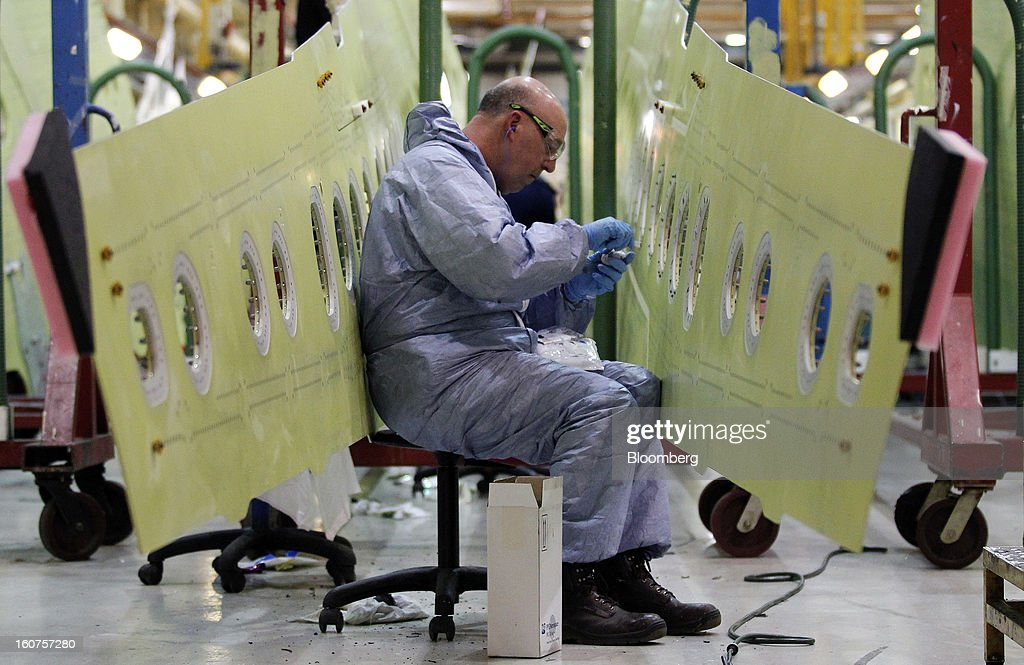 An employee works on sections of Airbus A320 single-aisle passenger aircraft wings during production at the company's factory in Broughton, U.K., on Monday, Feb. 4, 2013. Airbus SAS won a $9 billion order from Steven Udvar-Hazy's Air Lease Corp. that includes 25 A350 wide-body jets, a competitor to Boeing Co.'s grounded 787 Dreamliner. Photographer: Paul Thomas/Bloomberg via Getty Images