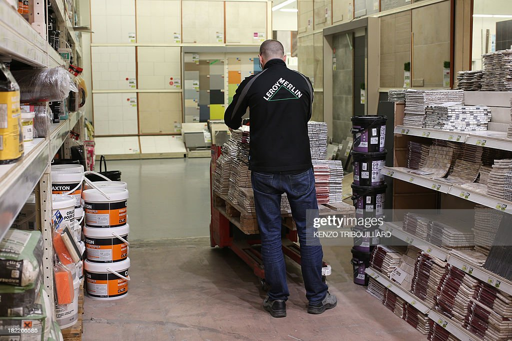 An employee works on September 29, 2013 in a French hardware store 'Leroy Merlin' in Paris. The Bobigny tribunal outside Paris sentenced on September 26, 2013 Leroy Merlin and another hardware chain, Castorama, not to open 15 of their stores on Sundays, but the two brands decided not to comply with the decision.