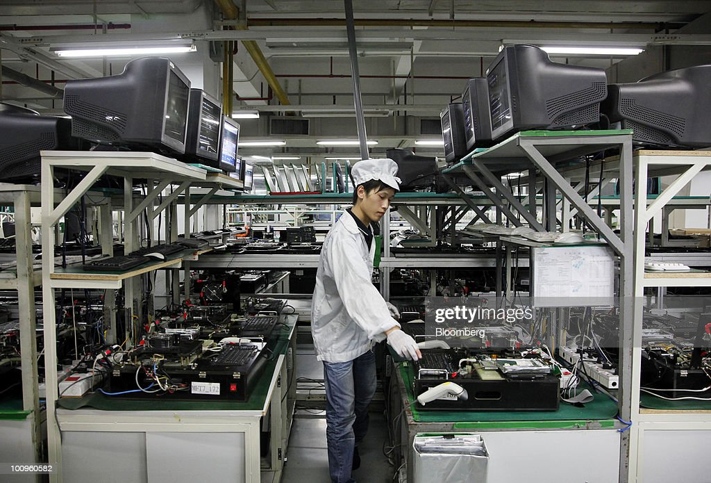 An employee works on the assembly line at Hon Hai Group's Foxconn plant in Shenzhen, Guangdong province, China, on Wednesday, May 26, 2010. Gou said nine of the 11 company workers who either committed suicide or attempted to had worked at the company less than a year, and six had been employed for less than a half-year. Photographer: Qilai Shen/Bloomberg via Getty Images