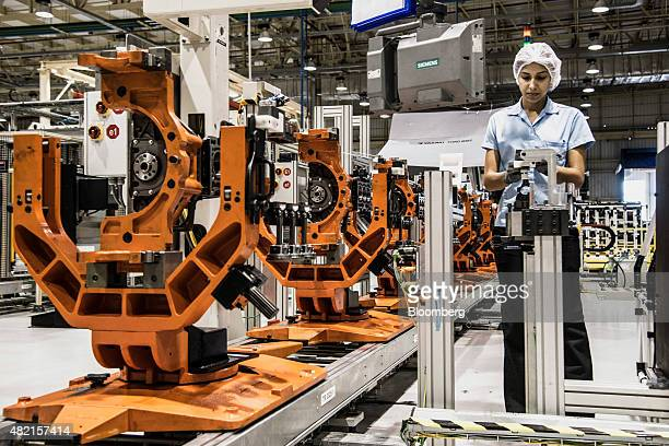 An employee works on the assembly line at the Ford Motor Co engine manufacturing facility in Camacari Brazil on Monday July 27 2015 Ford Motor Co...