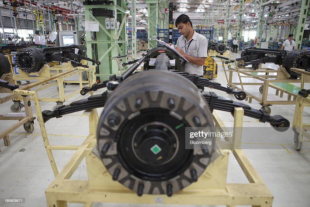An employee works on the assembly line for the Mahindra & Mahindra Ltd. Navistar truck at the company's factory in Chakan, Maharashtra, India, on Wednesday, Feb. 6, 2013. Mahindra & Mahindra is scheduled to announce third-quarter earnings today. Photographer: Kuni Takahashi/Bloomberg via Getty Images