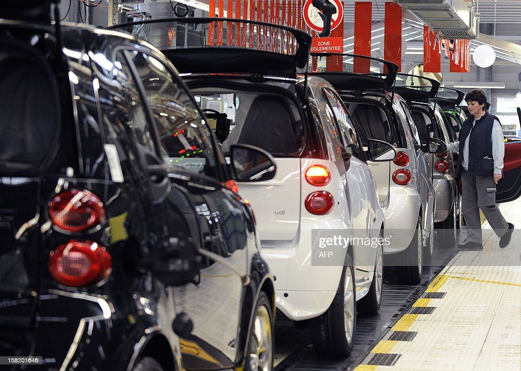 An employee works on the assembly line of the Smart ForTwo at the Smart car factory of Hambach, eastern France, on December 11, 2012. The third-generation Smart electric drive is scheduled to be launched in the U.S. and Europe by the second quarter of 2013 and Smart plans to mass produce the electric car with availability in 30 markets worldwide. VERHAEGEN