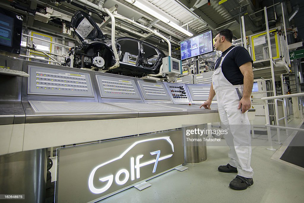 An employee works on the assembly line producing new Volkswagen Golf 7 cars at the Volkswagen factory on February 25, 2013 in Wolfsburg, Germany. Volkswagen Aktiengesellschaft announced its key financial data for fiscal year 2012 with sales revenue of EUR 192.7 billion, against the prior year of EUR 159.3 billion. The Group's operating profit of EUR 11.5 billion exceeded the prior-years record level.