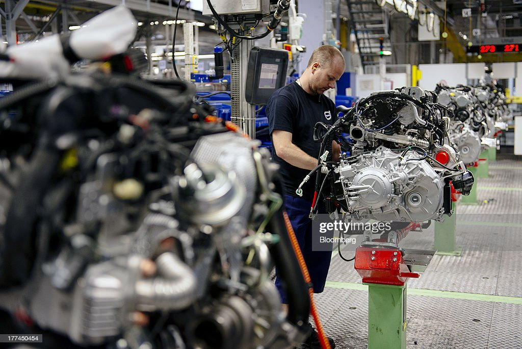 An employee works on the assembly of an automobile engine at the Volvo Cars plant in Torslanda, Sweden, on Thursday, Aug. 22, 2013. Volvo Cars Chief Executive Officer Hakan Samuelsson will settle a German investigation into corruption allegations linked to his tenure as MAN SE's CEO by paying 500,000 euros ($668,000) to charity. Photographer: Kristian Helgesen/Bloomberg via Getty Images
