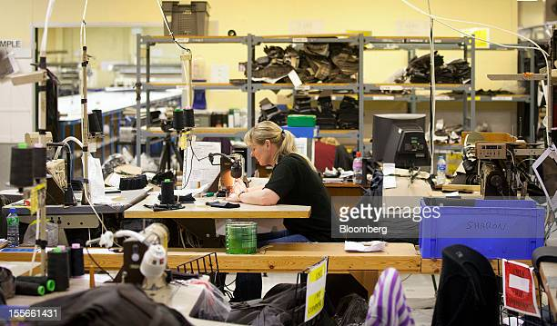 An employee works on the Barbour jacket production line at J Barbour Sons Ltd in South Shields UK on Tuesday Nov 6 2012 While the UK emerged from...