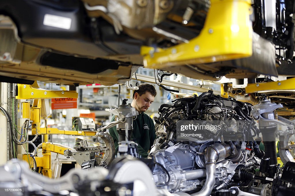 An employee works on the Bentley Continental automobile production line inside the Bentley Motors Ltd. workshop in Crewe, U.K., on Thursday, Nov. 29, 2012. Consumer spending and exports propelled the U.K. economy to its fastest growth since 2007 in the third quarter as the Olympics and a post-Jubilee rebound saw household expenditure rise the most in more than two years. Photographer: Simon Dawson/Bloomberg via Getty Images