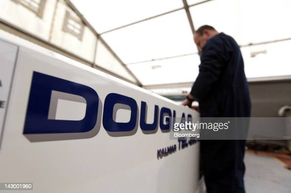 An employee works on the bodywork of an aviation towing tractor at the Douglas Equipment plant owned by CurtissWright Corp in Cheltenham UK on...