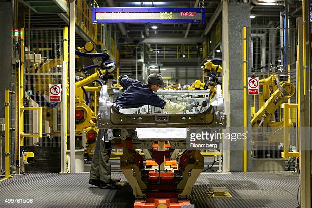 An employee works on the bodywork of an Infiniti Q30 automobile at the Nissan Motor Co production plant in Sunderland UK on Thursday Dec 3 2015...