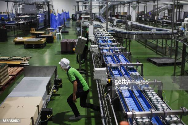 An employee works on the Carabao energy drink production line at the Carabao Group Pcl plant in Chachoengsao Chachoengsao Province Thailand on...