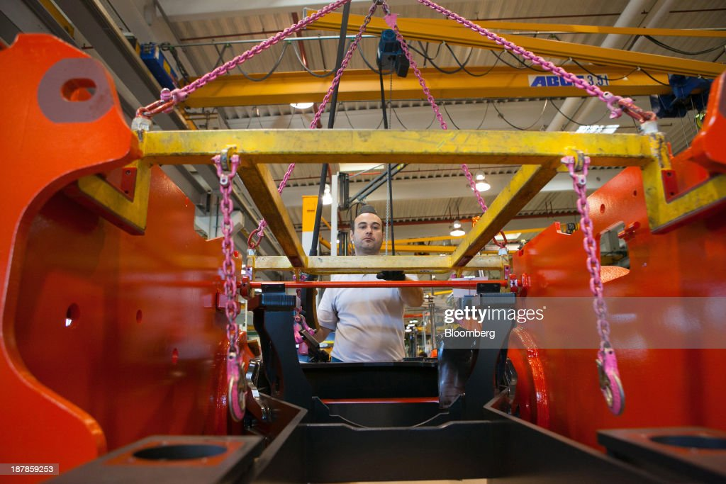 An employee works on the chassis for a Linde H50 forklift truck as its sits on the production line at the Linde Material Handling GmbH factory, a unit of Kion Group AG, in Aschaffenburg, Germany, on Tuesday, Nov. 12, 2013. Kion Group AG, the German forklift-maker which listed shares in June, is looking to expand its global sales network via acquisitions to catch up with main competitor Toyota Industries Corp. Photographer: Krisztian Bocsi/Bloomberg via Getty Images