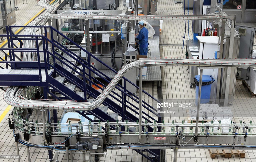 An employee works on the Cinzano Extra Dry vermouth semi-automated production line at Davide Campari-Milano SpA's factory in Novi Ligure, Italy, on Wednesday, Nov. 21, 2012. Business conditions in Italy, where Campari gets almost a third of annual revenue, are likely to remain volatile in the fourth quarter and early next year, Chief Executive Officer Bob Kunze-Concewitz said. Photographer: Alessia Pierdomenico/Bloomberg via Getty Images
