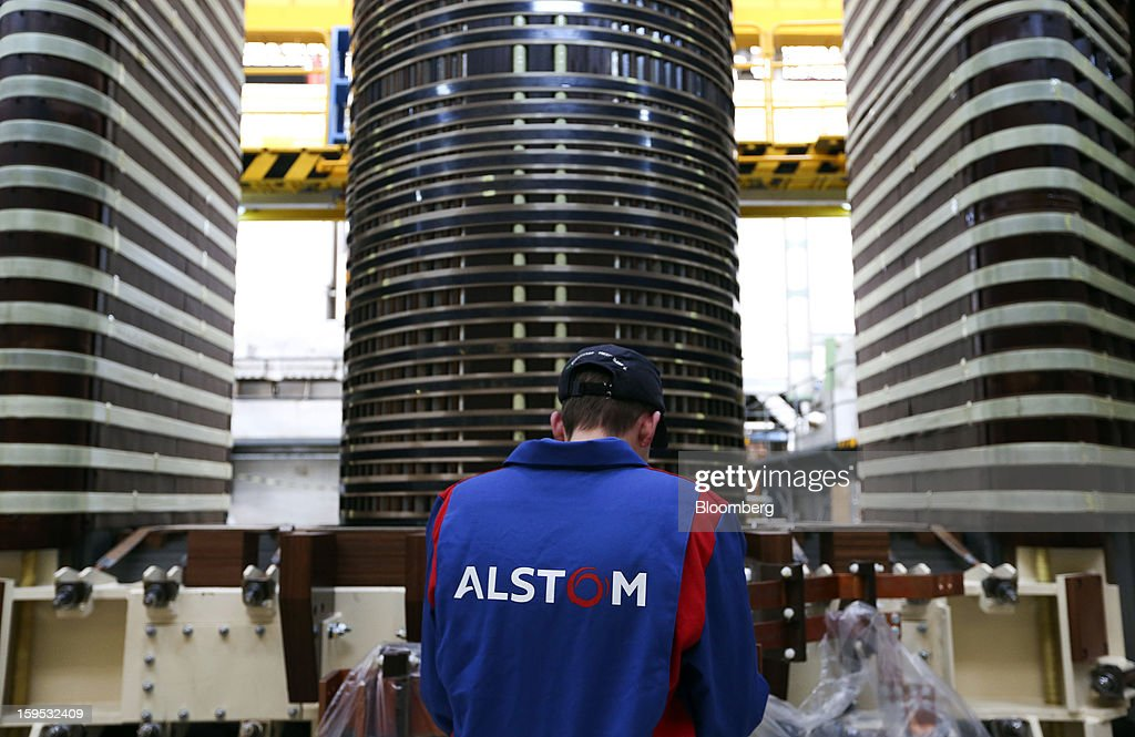 An employee works on the coil of an industrial power transformer at Alstom SA's factory in Stafford, U.K., on Tuesday, Jan. 15, 2013. Alstom surged 29 percent in Paris trading in 2012, beating the 15 percent gain of the the French benchmark CAC 40 Index. Photographer: Chris Ratcliffe/Bloomberg via Getty Images