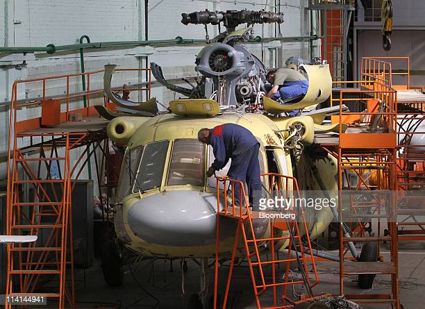 An employee works on the construction of a helicopter in the assembly shop at the JSC Kazan Helicopters factory operated by JSC 'Russian Helicopters'...