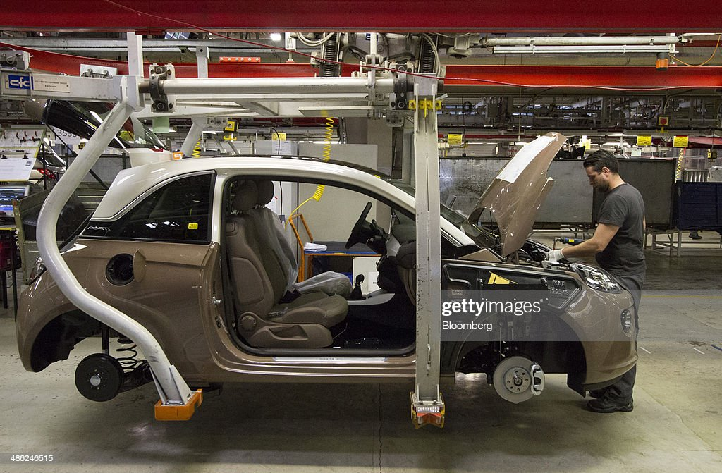 An employee works on the engine bay of an Adam Opel AG automobile at the Opel factory, operated by General Motors Co. (GM), in Eisenach, Germany, on Wednesday, April 23, 2014. European sales at Opel and its U.K. sister brand Vauxhall gained 8.5 percent to 226,888 cars in the first quarter, slightly better than the 8.1 percent increase for the market overall, according to ACEA data. Photographer: Martin Leissl/Bloomberg via Getty Images