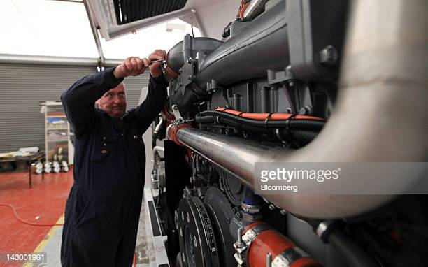 An employee works on the engine of an aviation towing tractor at the Douglas Equipment plant owned by CurtissWright Corp in Cheltenham UK on Tuesday...