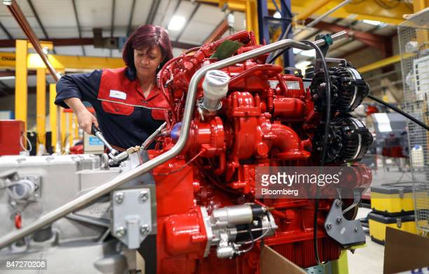 An employee works on the engine of an Enviro 200 bus at the Alexander Dennis Ltd factory in Guildford UK on Monday Sept 11 2017 Manufacturing in the...
