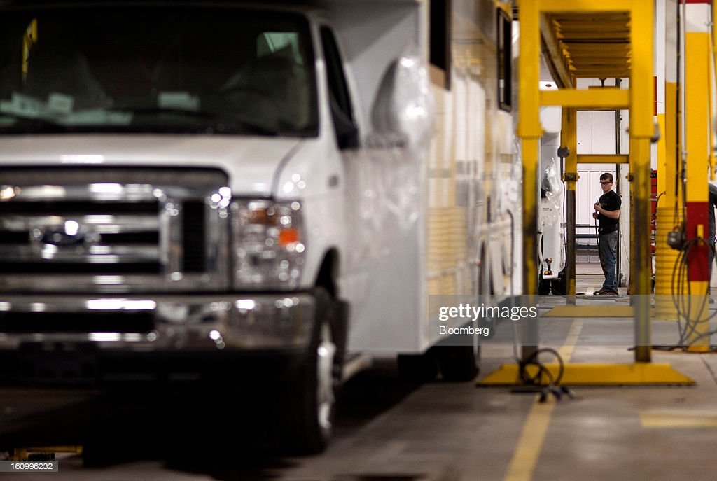 An employee works on the exterior of a Class C motorhome at Nexus RV in Elkhart, Indiana, U.S., on Friday, Feb. 8, 2013. Orders placed with U.S. factories increased less than forecast in December, reflecting a drop in non-durable goods that partly countered gains in construction equipment and computers. Photographer: Ty Wright/Bloomberg via Getty Images