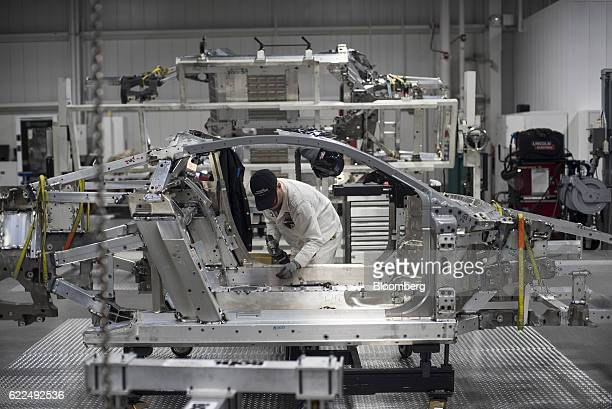 An employee works on the frame of a Honda Motor Co 2017 Acura NSX vehicle during production at the Honda Performance Manufacturing Center in...