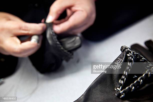 An employee works on the manufacture of Chanelbranded luxury leather gloves at the Causse Gantier factory in Millau France on Tuesday April 2 2013...