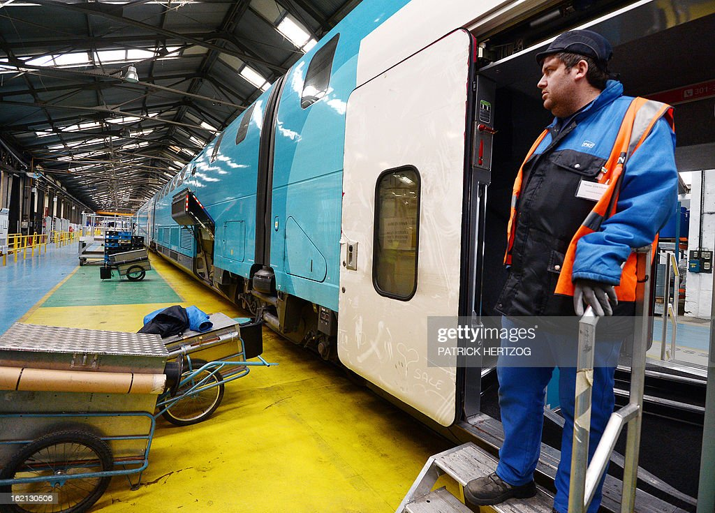 An employee works on the new low-cost TGV high-speed train 'Ouigo' at the assembling plant in Bischheim, eastern France, on February 19, 2013. France's state rail firm SNCF opened its online booking service for its new budget train service 'Ouigo' on February 19 inspired by the budget airline model. The train will start transporting its first passengers from April 2, with the Ouigo service operating from Marne-la-Vallée near Disneyland Paris, Lyon-Saint-Exupéry airport, Marseilles and Montpellier. AFP PHOTO / PATRICK HERTZOG