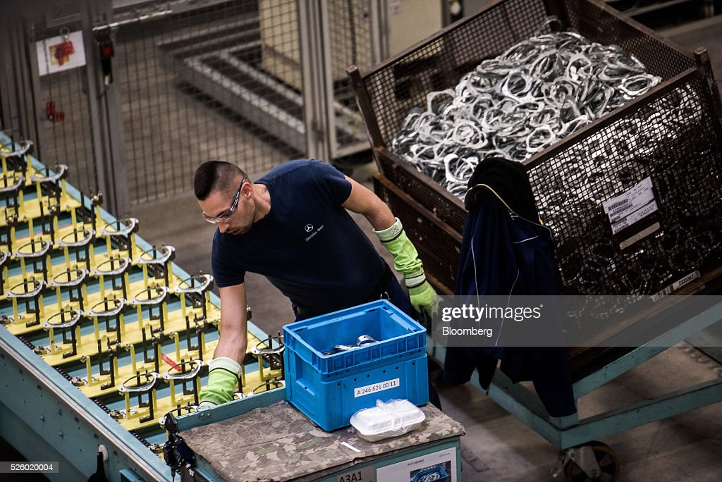 An employee works on the production line at the Mercedes-Benz AG automobile plant, operated by Daimler AG, in Kecskemet, Hungary, on Friday, April 29, 2016. Daimler's Mercedes factory will produce a new generation of compact vehicles, totalling Daimlers investment in Hungary to more than $1.8 billion. Photographer: Akos Stiller/Bloomberg via Getty Images