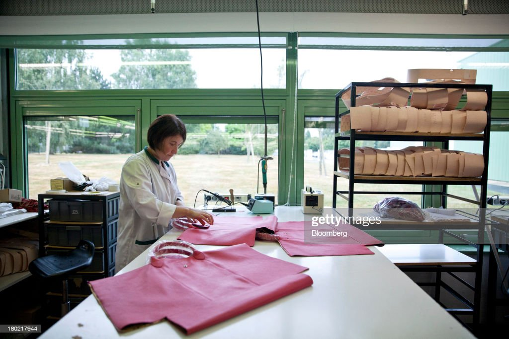 An employee works on the production of three Le Pliage Cuir bags at the Longchamp SAS workshop in Segre, France, on Monday, Sept. 9, 2013. Longchamp SAS, the French handbag maker, which is known for foldable Le Pliage nylon tote bags, expects sales in China to rise, Chief Executive Officer Jean Cassegrain said. Photographer: Balint Porneczi/Bloomberg via Getty Images