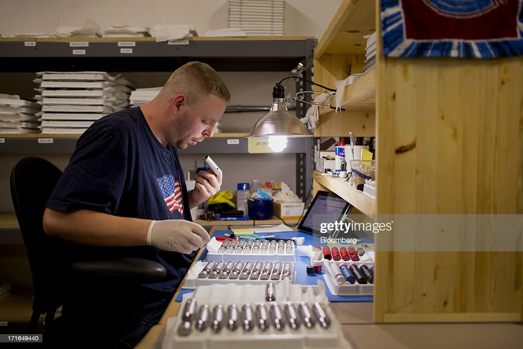 An employee works on the ProVari model electronic cigarettes production line at the ProVape Inc. facility in Monroe, Washington, U.S., on Wednesday, June 26, 2013. U.S. sales of electronic cigarettes are estimated to double in 2013 from last year, to $1 billion, according to estimates made by the Tobacco Merchants Association (TMA) and Mintel. Photographer: Mike Kane/Bloomberg via Getty Images