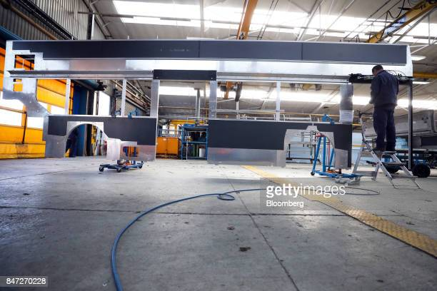 An employee works on the side body panel of an Enviro 400 bus at the Alexander Dennis Ltd factory in Scarborough UK on Wednesday Sept 13 2017...