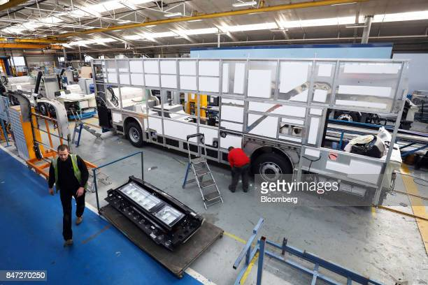 An employee works on the side panel of an Enviro 400 bus at the Alexander Dennis Ltd factory in Scarborough UK on Wednesday Sept 13 2017...
