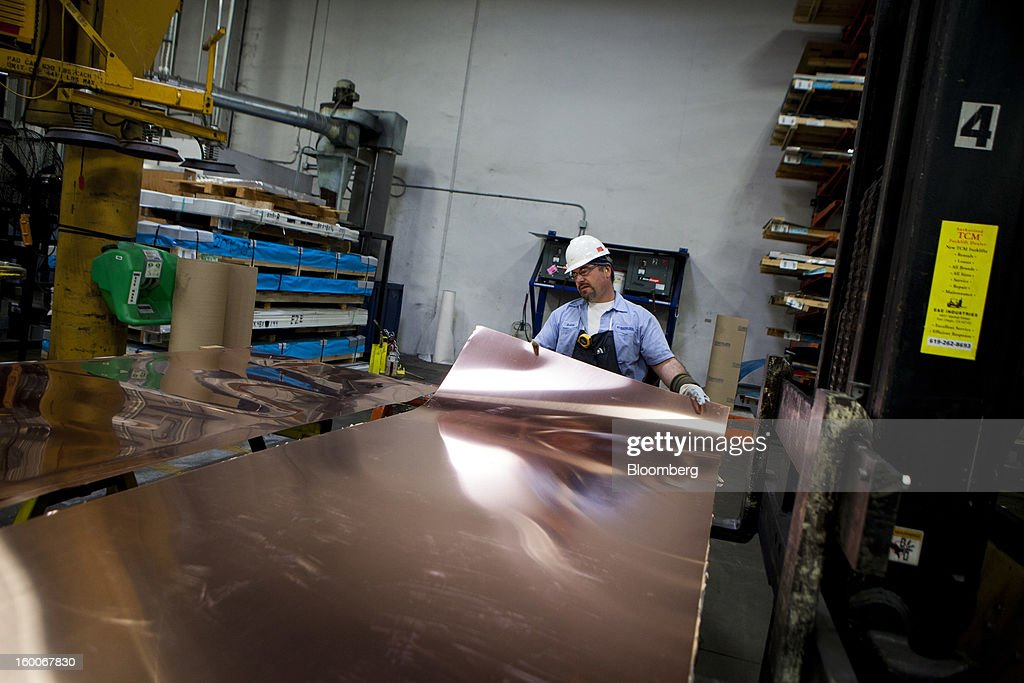 An employee works with copper sheets at Industrial Metal Supply Co.'s warehouse in San Diego, California, U.S., on Thursday, Jan. 24, 2013. Industrial Metal Supply Co. is an aluminum, steel and sheet metal supplier serving businesses and retail custmers. Photographer: Sam Hodgson/Bloomberg via Getty Images
