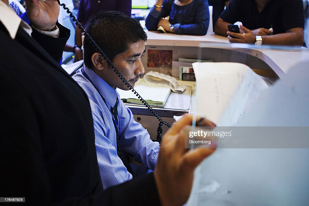 An employees processes payments at a service counter in the Wellness Center of the Indraprastha Apollo Hospitals facility, operated by Apollo Hospitals Enterprise Ltd., in New Delhi, India, on Wednesday, July 19, 2013. Prathap C. Reddy, the cardiologist who built the Apollo hospital chain valued at $2 billion over three decades in India, says hes seeking growth overseas as the nations visa policies drive medical tourists to rivals. Photographer: Prashanth Vishwanathan/Bloomberg via Getty Images