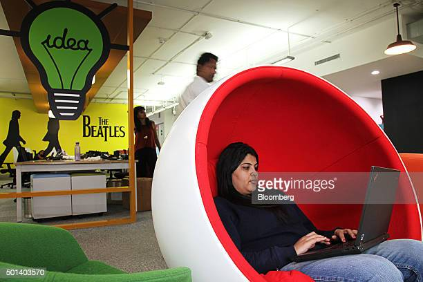 An employees sits in a chair working on a laptop computer in the office of Myntracom a unit of Flipkart Internet Services Pvt in Bangaluru India on...