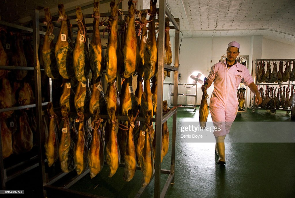 An emproyee of the company Fermin Jamones carries a leg of dry-cured Jamon Iberico de bellota in the village of La Alberca on December 14, 2012 near Salamanca, Spain. Fermin Jamones was the first Spanish company to be given an export licence for the lucrative United States market. Dry-cured Iberian ham or Jamon Iberico is a favourite amongst Spaniards and producers are hoping for improved sales over the busy christmas period. The jamon legs are usually dry-cured for up to three years after the pigs have been few on a diet of acorns in the last three months.
