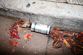 An emptied smoke grenade canister is seen on the sidewalk during a demonstration over recent grand jury decisions in policeinvolved deaths on...