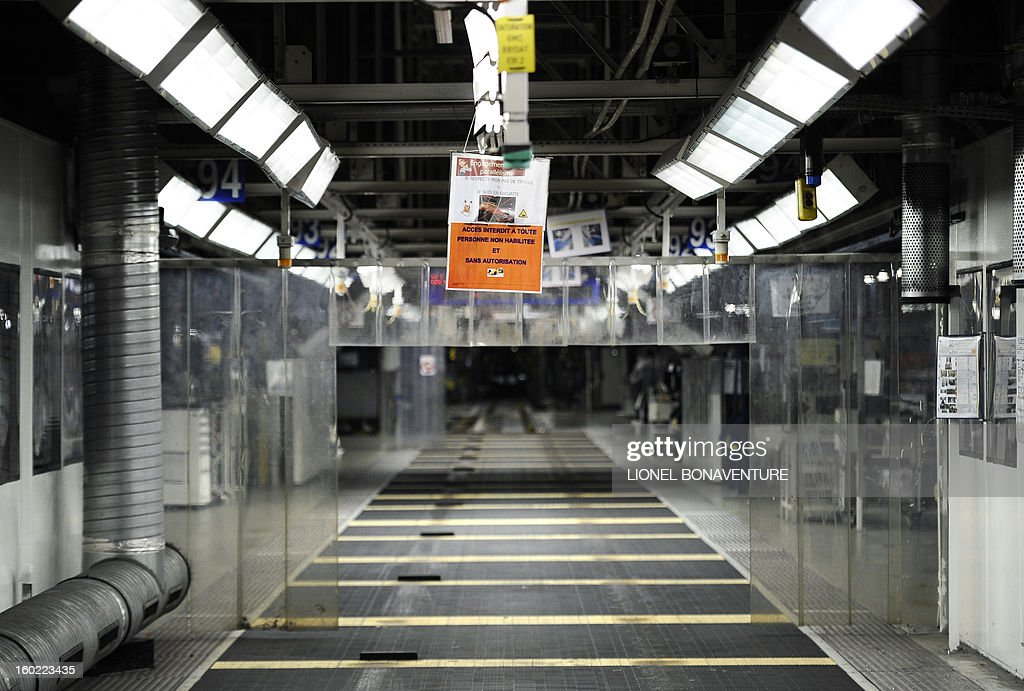 An empty assembly line is pictured on January 28, 2013 at the PSA Peugeot Citroen carmaker plant of Aulnay-sous-Bois, a Paris' suburb, as on-strike workers occupy the factory to protest against plans to sell the plant and lay off thousands of employees. AFP PHOTO LIONEL BONAVENTURE