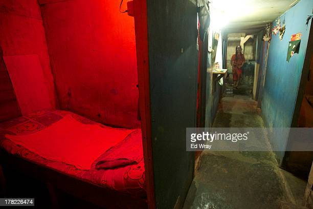An empty bed sits inside of a brothel in an arean known for prostitution on August 27 2013 in Jakarta Indonesia Brothel areas are one of the main...