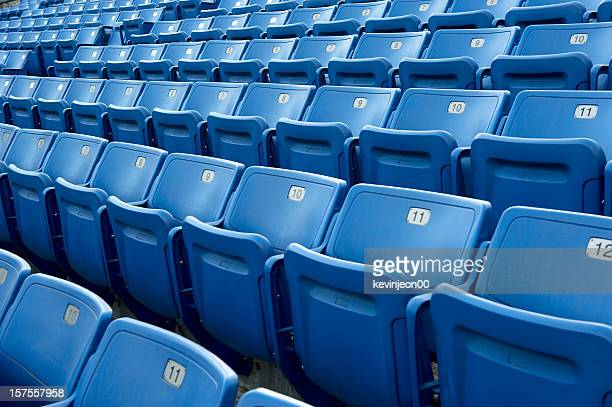 An empty blue arena seats with numbers