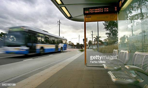 An empty bus stop at Woodpark in Sydney's west as a bus goes by is part of the dedicated roadway for the T Way bus service between Liverpool and...