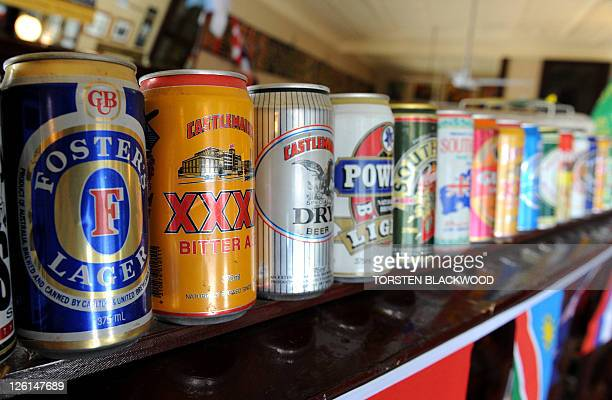 An empty can of Foster's Lager adorns the wall next to cans of other beers at the Australian Hotel in Sydney on September 23 2011 Foster's executives...