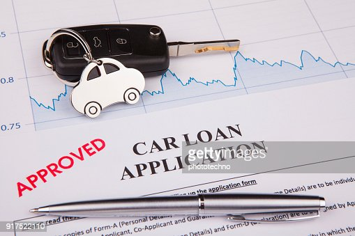 An empty car loan form with car key and a pen : Stock Photo